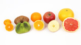 different fruit whole and sliced on white background