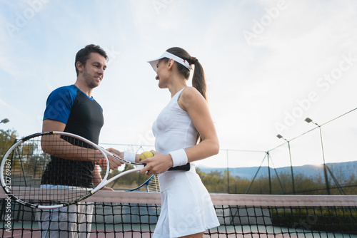 Aluminium Tennis Man and woman shaking hands after match of tennis