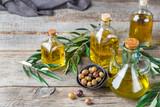 Assortment of fresh organic extra virgin olive oil in bottles - 212770213