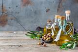Assortment of fresh organic extra virgin olive oil in bottles - 212770258