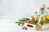 Assortment of fresh organic extra virgin olive oil in bottles - 212770427