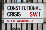 Street Sign altered to read 'Constitutional Crisis' in protest to the Brexit process outside Houses of Parliament in London, UK - 212774090