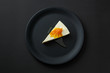 Dessert of cheesecake with jam on a black plate isolated on a black background - 212776684