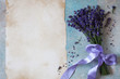 Background with bouquet of lavender, lilac bow and paper for text congratulations, wishes, invitation