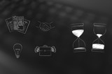 company and office-related icons next to before and after hourglasses depicting sand passing by - 212779083
