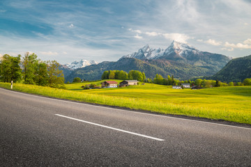 Empty asphalt country road with mountain scenery in summer