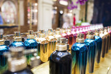 colorful perfume bottles on the counter - 212798068