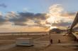 Empty windy beach at sunset