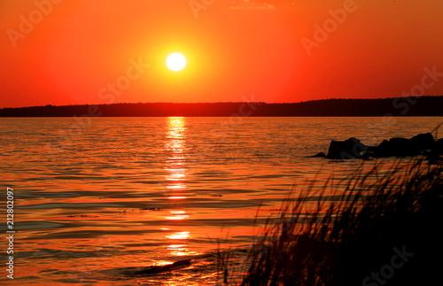 Aluminium Oranje eclat sunset on lake