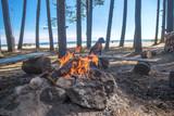 A bonfire burns in a camping i - 212809097