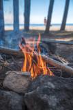 A bonfire burns in a camping i - 212809615