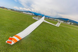 Image glider on the green lawn of the airfield.