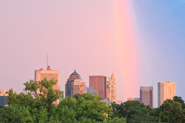 Looking south at the city of Columbus, Ohio skyline at sunset. A magical rainbow at dusk provided spectacular light.