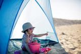 baby girl playing at summer beach