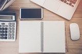 Mix of office supplies and gadgets on a wooden desk . - 212844862