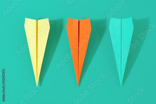 Top view creative travel background Flat lay colorful paper plane © kucherav