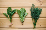 Spinach, green salad and dill on a wooden surface. Mix of greens. Healthy foods - 212852448