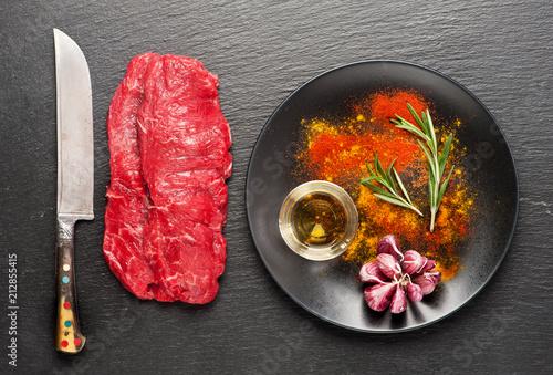 Aluminium Steakhouse Raw beef steaks, herbs and seasonings