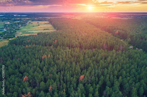 Fotobehang Zalm Aerial drone view of countryside, rural landscape with the beautiful cloudy sky at sunset