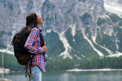 Portrait of a beautiful woman (girl) while she is looking at the mountains. Concept: Holiday, travel, happiness, freedom - 212870498