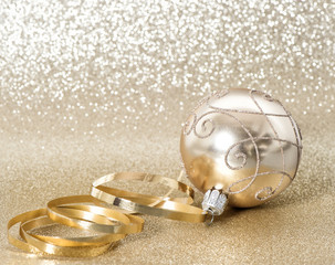Golden christmas ball blurred background Festive ornaments