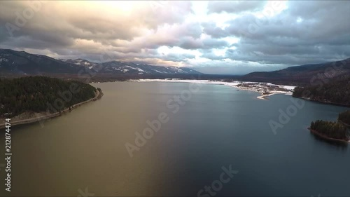 Wall mural Beautiful Mountain Sunset over Lake shot with Drone