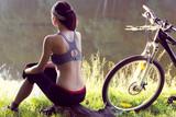 Girl cyclist  near the river - 212884242