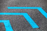 Corners of blue lines over dark asphalt - 212887431