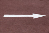 White arrow over red sport track, right move - 212887432