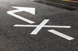 Crossed white arrow, road marking - 212887447