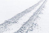 Car track perspective on snow, close-up - 212887475