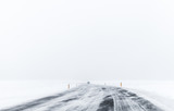 Lonely car on frozen road covered with snow - 212887476