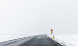 Frozen road covered with snow - 212887479