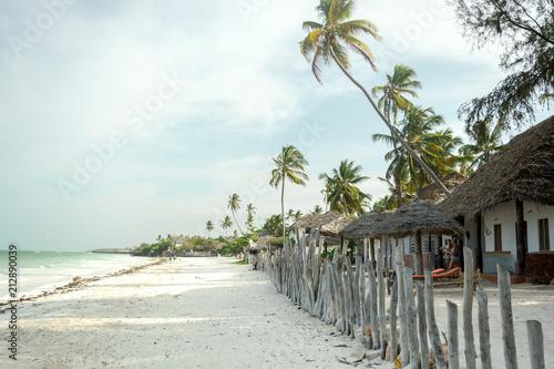 Foto Spatwand Zanzibar Jambiani, Zanzibar- February 26, 2017 - Uhuru resort. Beautiful tropical beach with palm trees