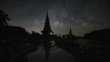 The Milky Way galaxy moving over two Pagodas. - 212890462