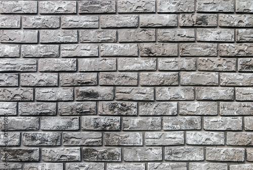 Fototapeta brick wall of decorative gray stone. background