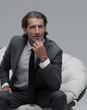 Leinwanddruck Bild - confident businessman sitting in chair