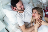 Young couple having romantic time in bedroom - 212897868