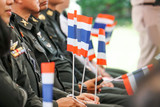 thai soldiers army in green uniform sit and hold thailand flag - 212900099