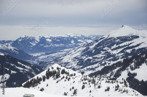some time spent in switzerland alps while skiing, mostly cloudy weather, but beautiful landscape view of mountain peaks - 212906421