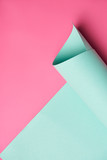 close-up view of rolled turquoise paper on creative pink background - 212908229