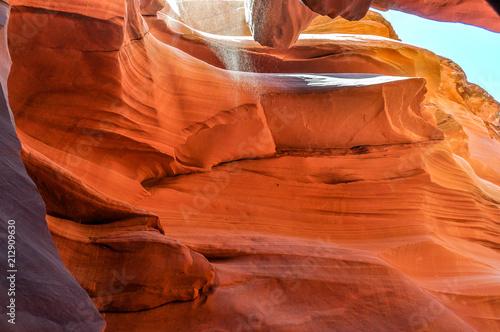 Fotobehang Rood traf. Drifting Grains of Sand Fall Into Antelope Slot Canyon near Page, Arizona