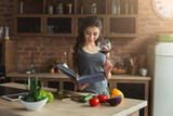 Happy woman preparing healthy food in kitchen - 212911661