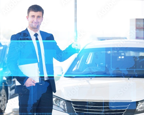 Wall mural Happy man with car dealer in auto