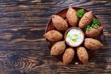deep fried kibbeh on a clay plate - 212936895