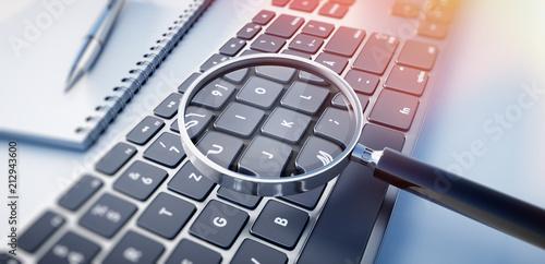 Leinwandbild Motiv Lupe auf schwarzer Tastatur