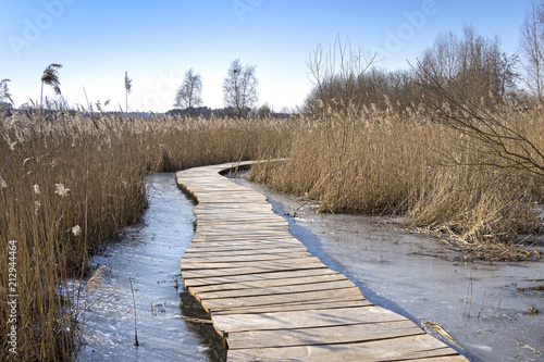 Plexiglas Pier Cold winter day, wooden path in the Uckermark