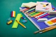 Colorful school supplies on wooden table background