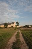 Rural landscape, path through a meadow leading to the farm - 212949045