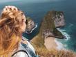 Leinwanddruck Bild - Pretty girl traveler at Kelingking Beach in Nusa Penida, Bali, Indonesia